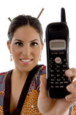 Attractive female showing cell phone — Stock Photo