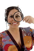 Japanese female with magnifying glass — Stockfoto