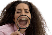 Corporate woman with magnified mouth — Stock Photo