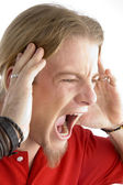 Close up of male shouting loudly — Stock Photo