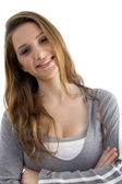 Attractive young female with folded arms — Stock Photo