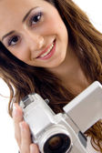 Young female holding handy cam — Stock Photo