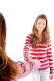 Friendly girls shaking hands and smiling — ストック写真