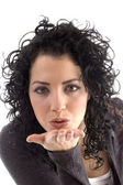 Attractive female giving flying kiss — Stock Photo