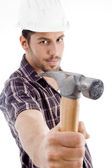 Architect showing hammer to camera — Stockfoto