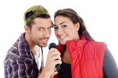 Young male and female singer with mic — Стоковое фото