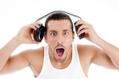 Astonished male listening music — Stock Photo