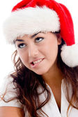 Close up of woman wearing christmas hat — Stock Photo