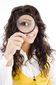 Young girl holding magnifier — Stock Photo
