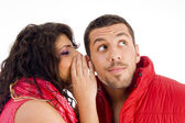 Loving caucasian pair whispering — Stock Photo