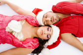 Loving american couple lying on floor — Stock Photo