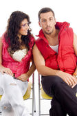 Young lovable couple resting on chair — Stock Photo