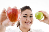 Model showing green and red apples — Stock Photo