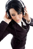 Businesswoman tuned in music — Stock Photo