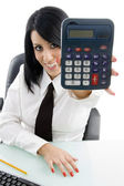 Woman showing calculator to camera — Stok fotoğraf