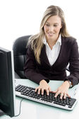 Blonde woman working on computer — Stock Photo