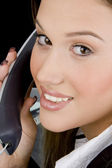 Close up of woman holding receiver — Stock Photo