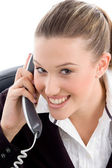 Young female executive busy on phone — Stock Photo
