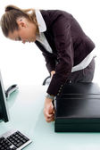 Woman closing the briefcase in office — Stock Photo