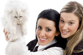Young women holding pet cat — Stock Photo