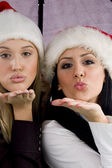 Young women blowing flying kiss — Stock Photo