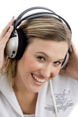 Smiling woman tuned in music — Stock Photo