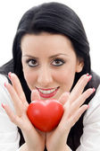 Caucasian model holding small red heart — Stock Photo