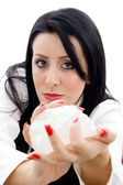 Caucasian female holding a rock — Stock Photo