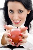 Caucasian female holding an apple — Stock Photo