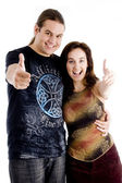 Couple embracing and showing thumbs up — Stock Photo