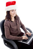 Young female working on laptop — Stock Photo