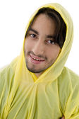 Man with raincoat posing — Stock Photo