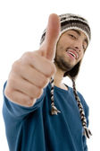 Side pose of young male with thumbs up — Stock Photo