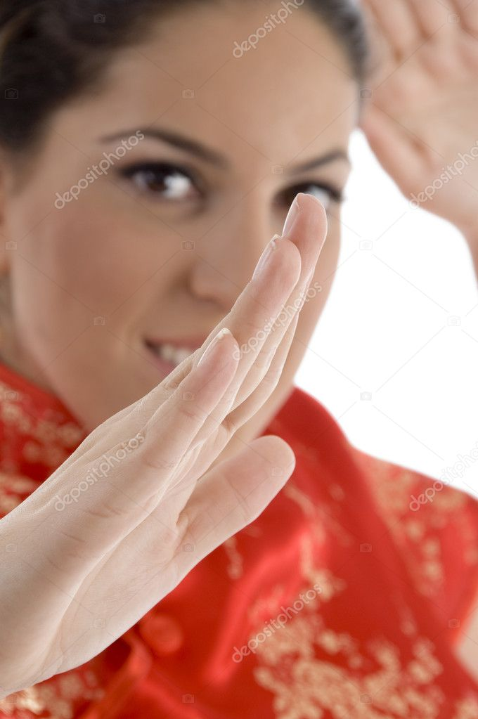 Close up of woman showing karate gesture with white background — Stock Photo #1662242