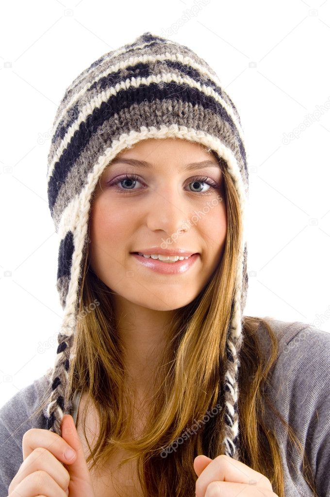 Portrait of attractive female wearing woolen cap on an isolated background — Stock Photo #1664235
