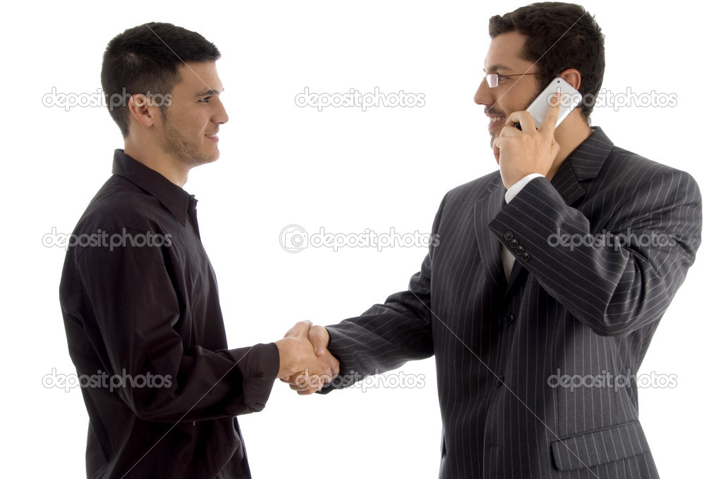 Businesspeople communicating and shaking hand against white background — Stock Photo #1666407