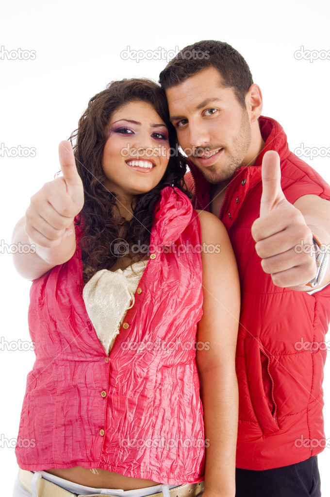 Young friends showing thumbs up on an isolated background — Stock Photo #1667408
