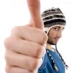 Man wearing winter cap showing thumbs up — Stock Photo #1670011