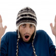 Frightened young man wearing woolen cap — Stock Photo