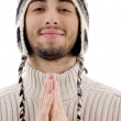 Young guy praying with joined hands — Stock Photo