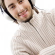 Happy young guy busy with music — Stock Photo