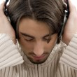 Young handsome male enjoying music — Stock Photo