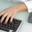 Female hand operating keyboard — Stock Photo
