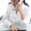Young woman answering call and working — Stock Photo