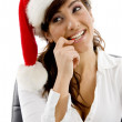 Shy female executive in christmas hat — Stock Photo