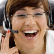 Pleased female customer care executive - Stock Photo