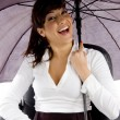Stock Photo: Female executive under umbrella