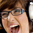 Close up of young woman tuned to music — Stock Photo