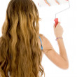 Back pose of girl with paint brush — Stock Photo #1672381