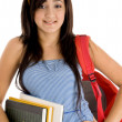 Student posing with bag and books — Stock Photo